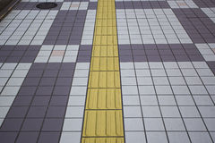 Blind floor tiles on public walkway Stock Images