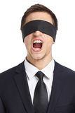 Blind-folded businessman screams Royalty Free Stock Photo