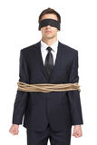 Blind-folded businessman tied with the cord Royalty Free Stock Photography
