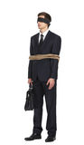 Blind-folded businessman tied with the rope. Full-length portrait of blind-folded businessman tied with the rope, isolated on white. Concept of slavery and Royalty Free Stock Photo