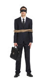 Blind-folded businessman tied with the string. Full-length portrait of blind-folded businessman tied with the line, isolated on white. Concept of slavery and Stock Images
