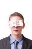 Blind gemacht durch das Geld Lizenzfreie Stockfotos
