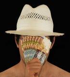 Blind gemacht durch Geld Lizenzfreie Stockfotos