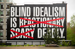 Blind idealism is deadly. NEW YORK CITY - MAY 1, 2016: catchy saying at the High Line Park in the eastern part of Manhattan Royalty Free Stock Image
