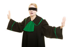 Blind justice. Woman covering eyes with blindfold. Blind justice. Woman lawyer attorney wearing classic polish (Poland) black green gown covering eyes with Stock Photos