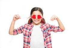 Blind love. Small girl covering eyes with hearts. Cute girl with small red hearts on sticks. Small child with heart. Shaped decorations. Happy valentines day stock images