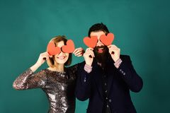 Blind love symbol and dating concept. Girl and bearded man. Blind love symbol and dating concept. Girl and bearded men with happy faces play with paper hearts royalty free stock photography