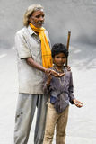 A blind man begging for money with the help of a young boy - India Royalty Free Stock Photography