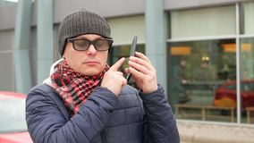 Blind Man With Blindness Using Digital Assistant On Smartphone