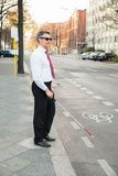 Blind man crossing road Stock Image