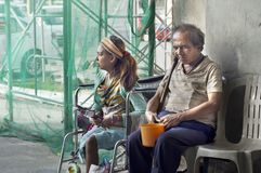 Blind Man beside disabled Beggar at Church Portal are familiar scenes found in public places. San Pablo City, Laguna, Philippines – January 9, 2016: Blind Man Stock Photography
