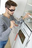 Blind man in kitchen. Blind man in his kitchen Stock Image