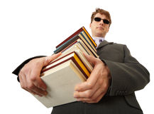 Blind man holding stack of books Royalty Free Stock Image