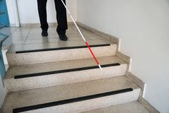 Blind man moving down on stairway Stock Images