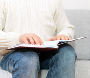 Blind man reading braille book. Royalty Free Stock Photography
