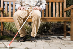 Blind man sitting on a bench Stock Image