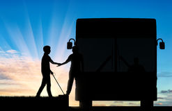 Blind man with to cane helping get on bus day Royalty Free Stock Photography