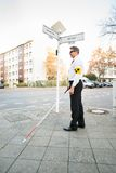 Blind Man Wearing Armband Crossing Road Royalty Free Stock Image