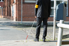 Blind Man With White Stick On Street Royalty Free Stock Photos
