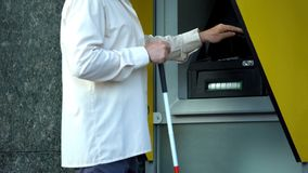 Free Blind Man Withdrawing Money From Atm, Searching Tactile Indicator To Insert Card Stock Photo - 159228980