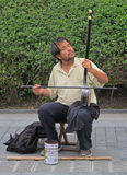 Blind musician is playing on the street in Stock Photography