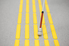 Blind pedestrian walking on tactile paving Stock Images