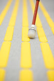 Blind pedestrian walking on tactile paving Royalty Free Stock Images