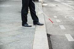 Blind person crossing street Royalty Free Stock Photo