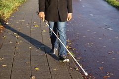 Blind person with walking stick royalty free stock images
