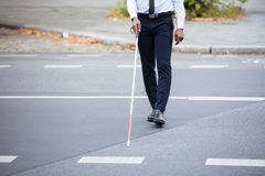 Blind Person Walking On Street. Blind Person With White Stick Walking On Street royalty free stock photos