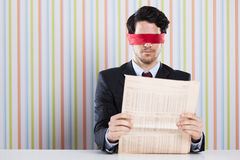 Blind reading a newspaper Stock Image