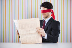 Blind reading a newspaper Royalty Free Stock Photo