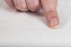 Blind reading text. In braille language Royalty Free Stock Images