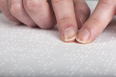 Blind reading text. In braille language Royalty Free Stock Photography