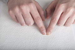 Blind reading text. In braille language Stock Images
