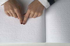 Blind reading text in braille language Stock Photos