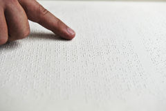 Blind reading text in braille language Royalty Free Stock Images