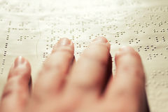 Blind reading text in braille language Stock Images