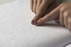 Blind reading text in braille language Stock Image