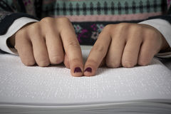 Blind reading text in braille language Royalty Free Stock Photos