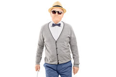 Blind senior gentleman walking with a stick stock photos