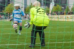 Blind soccer game. A handicapped blind girl shooting the ball to the goal royalty free stock photos