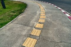 Blind tactile way. Tactile paving for blind handicap on concrete pathway Royalty Free Stock Photos