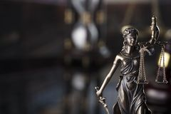 Law symbols in the old university library. Blind Themis statue with scale of justice. Library background. Place for text or logo royalty free stock photography
