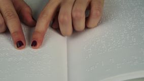 Blind woman reading text in braille language Royalty Free Stock Photography