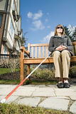 Blind woman sitting on a bench stock images