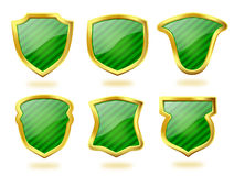 Blindajes verdes rayados con el marco de oro Foto de archivo
