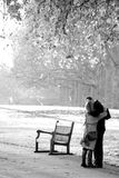Blinded by love. Hugs and kisses, middle age couple, Saint James park, London Royalty Free Stock Images