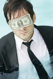 Blinded By Money Royalty Free Stock Image