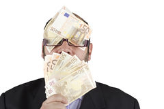 Blinded by money Royalty Free Stock Photo